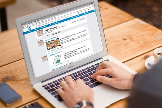hands typing on Linkedin in a laptop