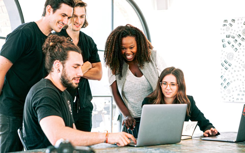 Employees looking at a computer screen.jpg