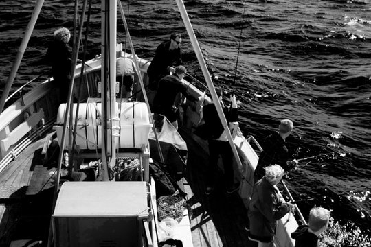 People sailing in the ocean, black and white
