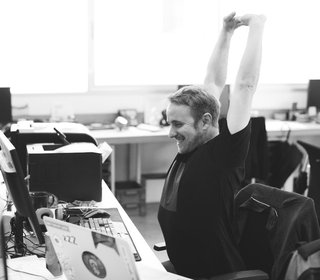 salesperson celebrating a sale in the office
