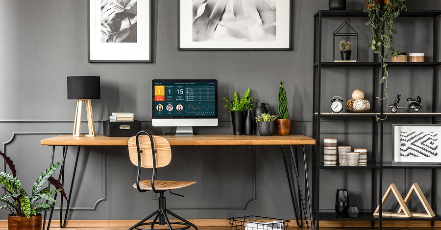 home office displaying Plecto on the computer screen