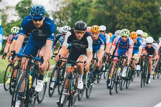 Men bike race on the road